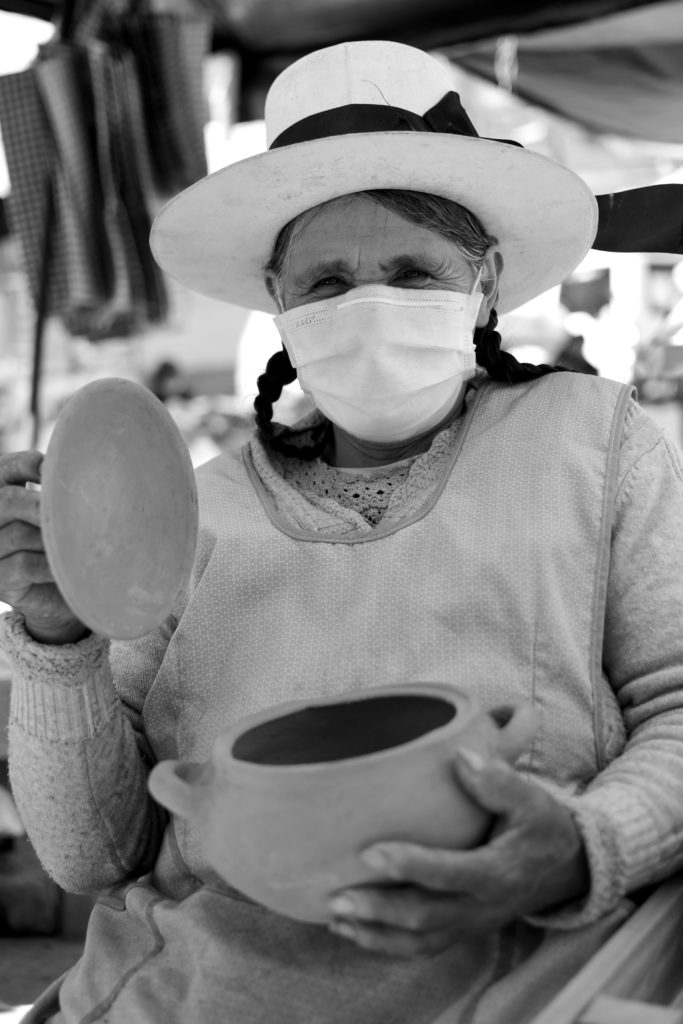 Market-woman with mask in Abancay